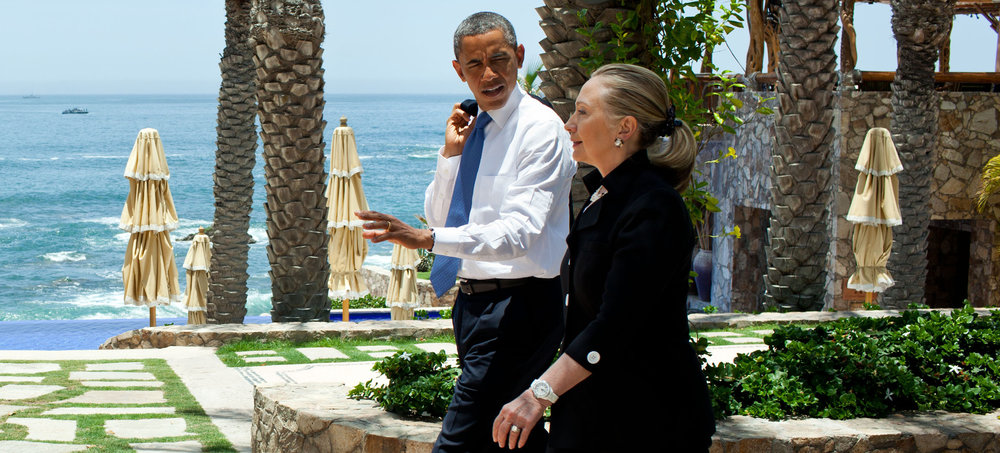 President OBama and Secretary Clinton discussing watches. Obviously. Photograph By Pete Souza, wikimedia.