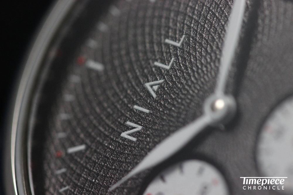 Niall GMT Black Swan dial macro 9.JPG