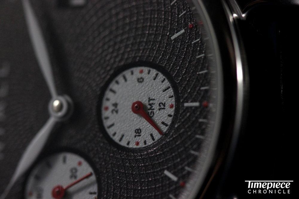 Niall GMT Black Swan dial macro 2.JPG