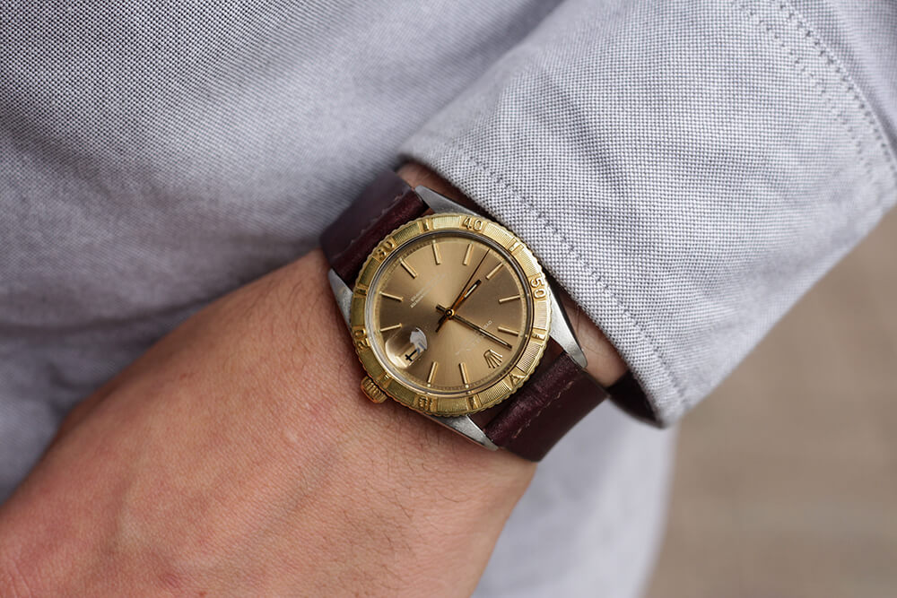 Rolex Turn-o-graph with yellow gold bezel. Photo courtesy of Theo & Harris.
