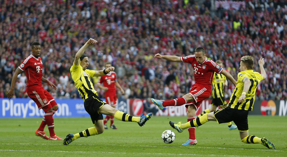 Frank Ribery (second from right) has his shot blocked by two Borussia Dortmund defenders in the 2013 UEFA Champions League Final. Both German clubs were managed by German coaches and the match featured 18 German players; a sign of a strong production line from the DFB. Action Images/ John Sibley