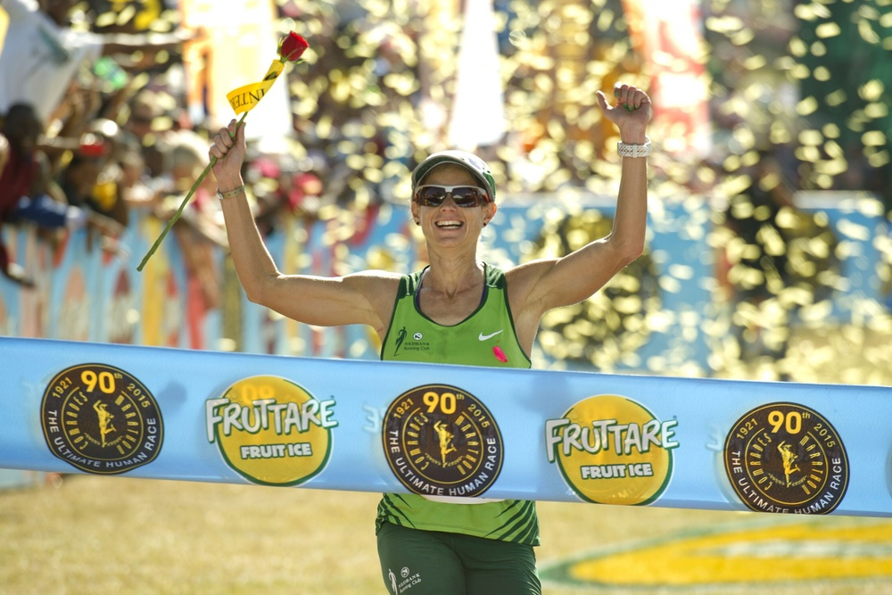 Caroline Wöstmann celebrates her 2015 Comrades Marathon victory. Her ability to manage the massive 90km race into smaller segments meant she was able to achieve small victories along the way. Image supplied by Haiko Wöstmann