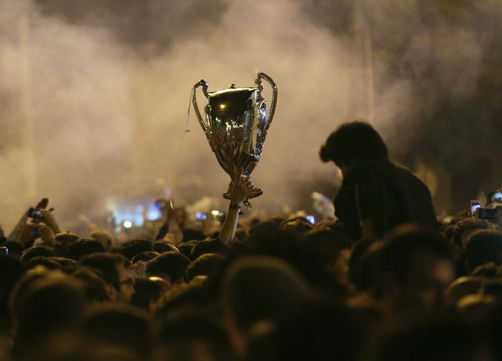 A fan holds aloft a replica of the UEFA Champions League trophy last year in Madrid after Real Madrid won their 10th European title. 'La Decima' had become an obsession for Real and their fans and a huge weight was lifted when they beat city rivals Atletico Madrid in extra time. Image supplied by Action Images/ Andrea Comas.