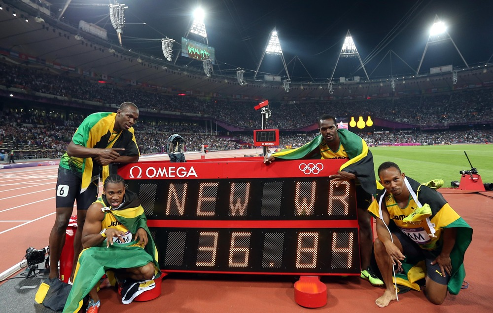 Usain Bolt, Yohan Blake, Nesta Carter, and Michael Frater (from L to R) of Jamaica celebrate after the men's 4x100m relay final at London 2012 Olympic Games. The Jamaican team won gold medal with a new world record of 36.84. Image Supplied by Action Images / Liao Yujie