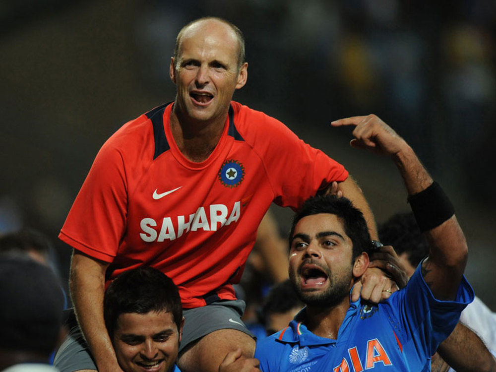 Gary Kirsten (C) celebrates with the Indian players after winning the 2011 Cricket World Cup. Kirsten initially faced challenges as the new coach of a team with great expectations but found his feet after establishing himself with senior players.
