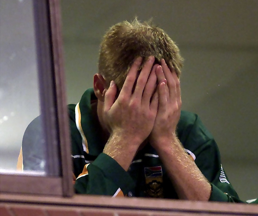 Former South African captain Shaun Pollock is left distraught as his team fail to qualify for the next round during the 2003 World Cup on home soil. The Proteas drew the match against Sri Lanka in Durban after they miscalculated the amount of runs needed for victory. Picture supplied by Action Images. Photographer Mike Hutchings