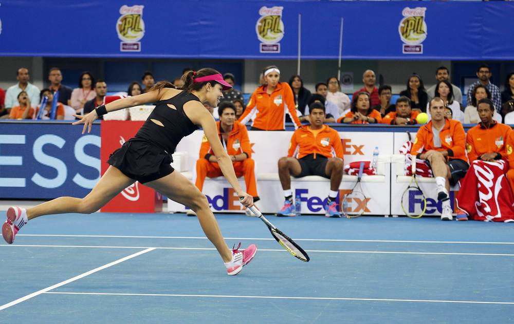 Indian Aces' Ana Ivanovic of Serbia hits a return UAE Royals' Kristina Mladenovic of France during their match at the International Premier Tennis League (IPTL) in Dubai December 13, 2014. Image supplied by Action Images / Ahmed Jadallah