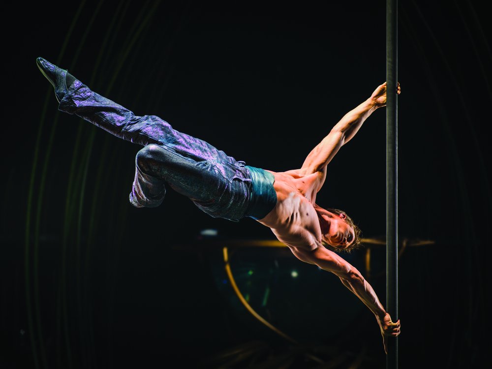 A performer demonstrates extreme athletic ability during a Cirque du Soleil performance, the kind of athletic ability that elite gymnasts have honed through years of competition. Image supplied by Cirque du Soleil.