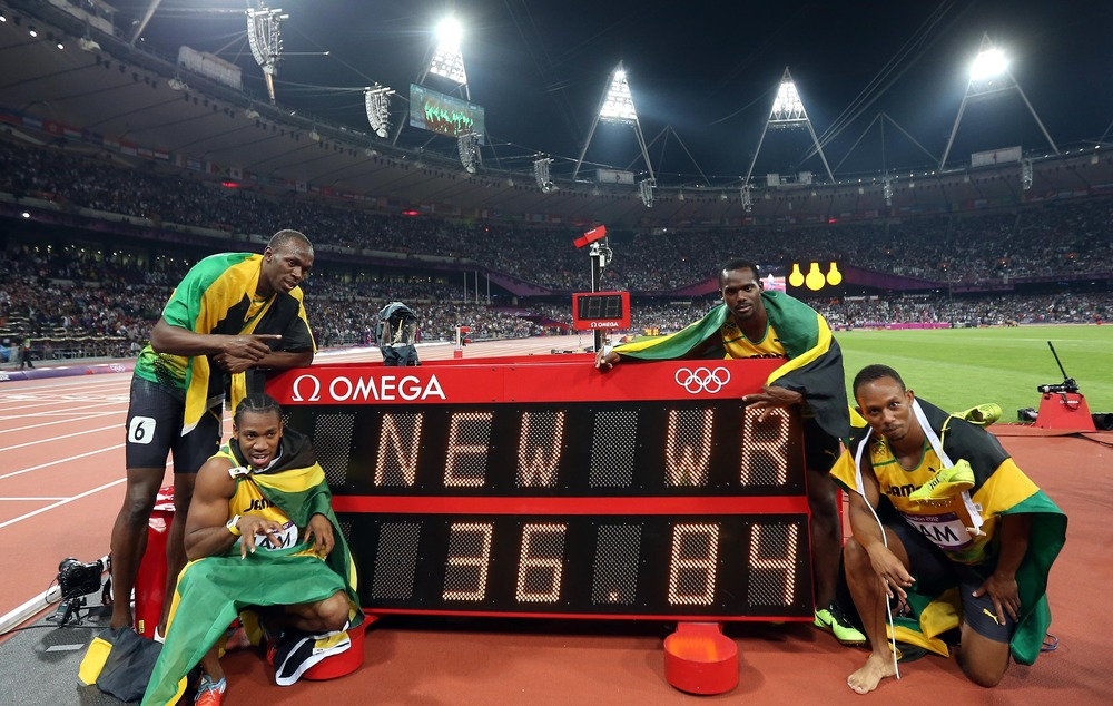 Usain Bolt,Yohan Blake, Nesta Carter, and Michael Frater (from L to R) of Jamaica celebrate after the men's 4x100m relay final at London 2012 Olympic Games.The Jamaican team won gold medal with a new world record of 36.84. Image Supplied by Action Images / Liao Yujie