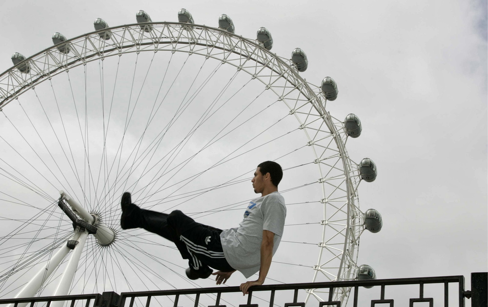 Majora, (real name Marwan Elgamal) demonstrates free-running in front of the London Eye. Freerun, is based on the theory of Parkour, which uses the body to get from A to B as quickly and efficiently as possible, but its practitioners place greater emphasis on individual expression, creative flow and artistic merit. Image supplied by Action Images/Luke MacGregor