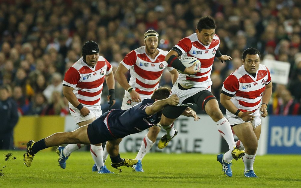 Japan's Ayumu Goromaru evades USA's Phil Thiel during their group game encounter at the 2015 Rugby World Cup. Japan has surpassed the USA on the global stage and has developed a strong rugby identity in their nation.  Image supplied by Action Images/Andrew Boyers.