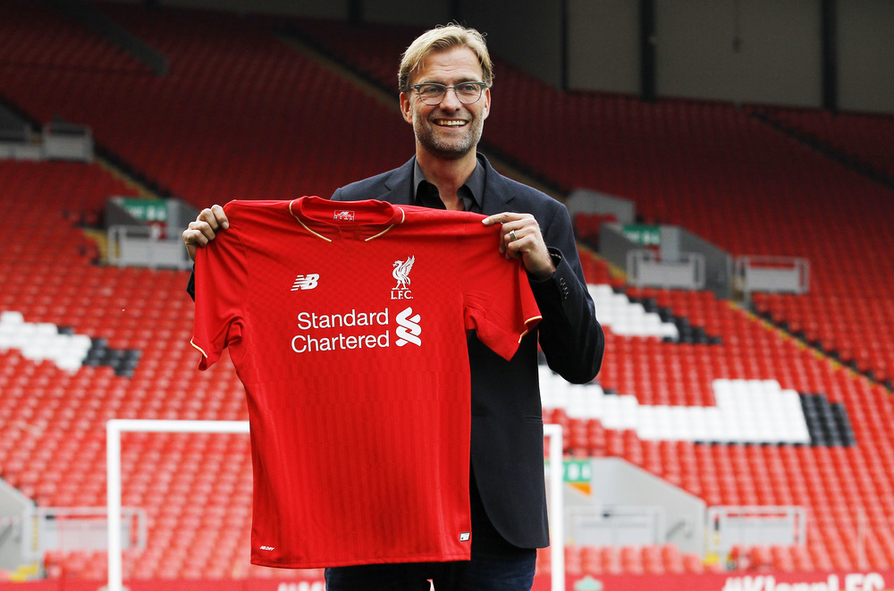 New Liverpool manager Jürgen Klopp poses after the press conference. He comes to Anfield with a weight of expectation and faces a difficult challenge as the new manager of a prominent club. Image supplied by Action Images / Craig Brough.