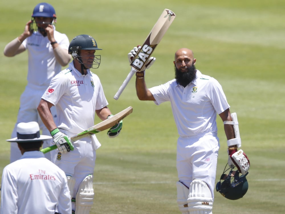 Hashim Amla (r) celebrates scoring a hundred against England while AB de Villiers applauds. de Villiers replaces Amla as South Africa's Test captain. Image supplied by Action Images / Mike Hutchings.