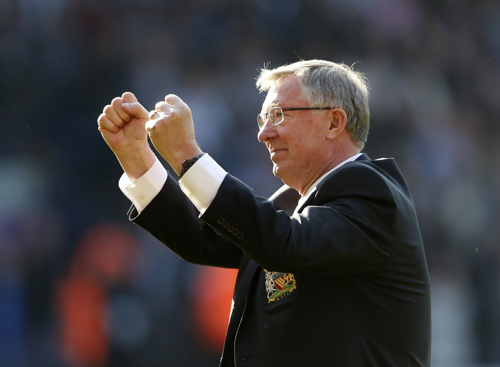 Sir Alex Ferguson is arguably the greatest coach that has ever been in charge of an elite sports team. Here he celebrates with fans after his 1 500th and final match in charge of Manchester United against West Bromwich Albion in 2013.  Image supplied by Action Images / Eddie Keogh