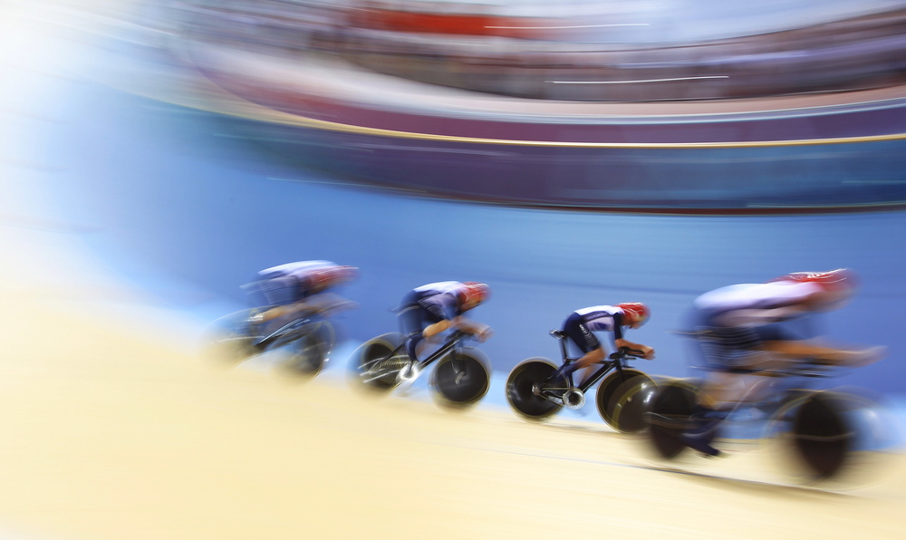 Great British Cycling Team's men's team pursuit in action at the London 2012 Olympic Games. GBCT would go on to win 8 golds for the second consecutive Games.  Image supplied by Action Images / Jason O'Brien .