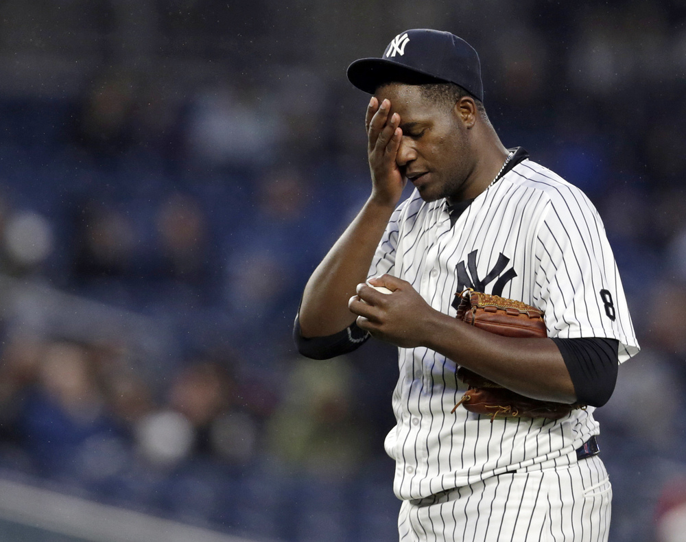New York Yankees starting pitcher Michael Pineda (35) reacts during the second inning against the Boston Red Sox at Yankee Stadium.  Image supplied by Action Images / Adam Hunger.