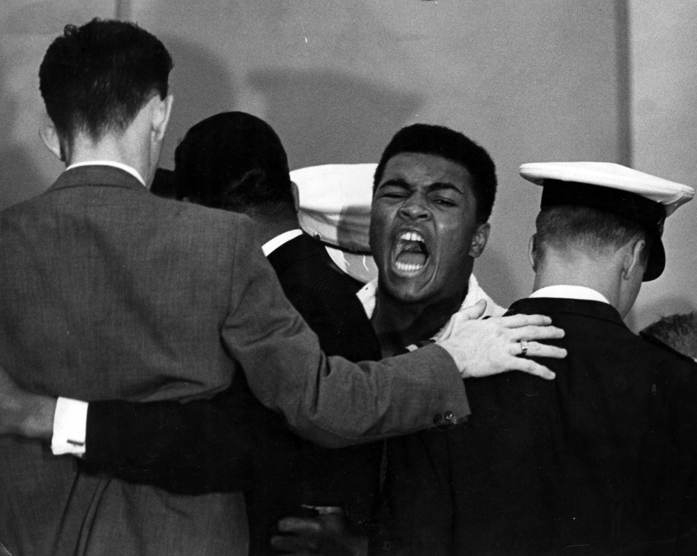 Muhammad Ali (the Cassius Clay) hours before his first title fight with Sonny Liston. Ali flew into a rage and had to be restrained by several people. Ali's trash talk was otherworldly and unrivalled.  Image supplied by Action Images.