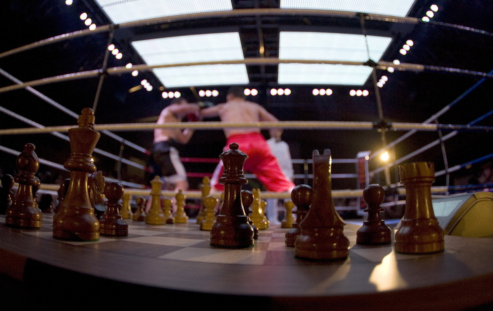 Germany's Frank Stoldt (R) delivers a punch to David Depto from the U.S. during the first chess boxing light heavyweight world championship fight in Berlin November 3, 2007. Stoldt won the competition that consists of up to 11 alternating rounds of boxing and 'blitz' chess sessions.  Image supplied by Action Images / Tobias Schwarz.