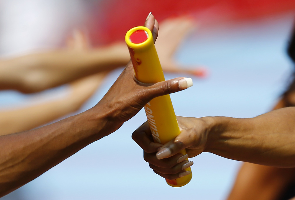 A member of the U.S. team passes the baton to her teammate during their women's 4 x 400 metres relay heat at the 15th IAAF Championships at the National Stadium in Beijing, China August 29, If coaches could pass on knowledge as seamlessly and efficiently as this, the long term benefits could be staggering.  Image supplied by Action Images / Kai Pfaffenbach.