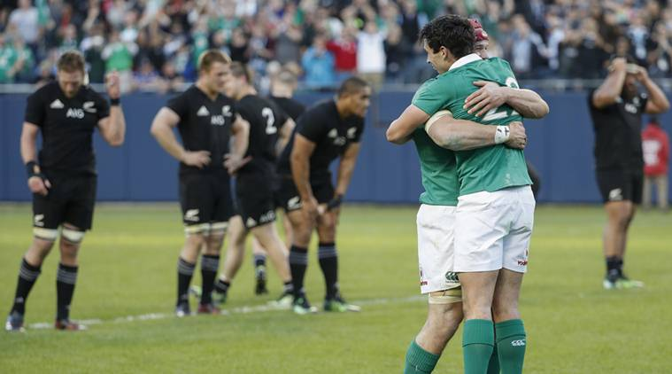 Ireland players rejoice in their first ever victory over the All Blacks in 111 years. The defeat at Soldier Field stadium, Chicago, ended a run of 18 consecutive Test victories for New Zealand.
