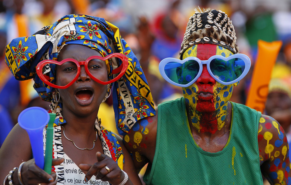 An expanded FIFA World Cup would see more fans, like these two from the DRC, cheer their nation on participate in an event that includes their national team.