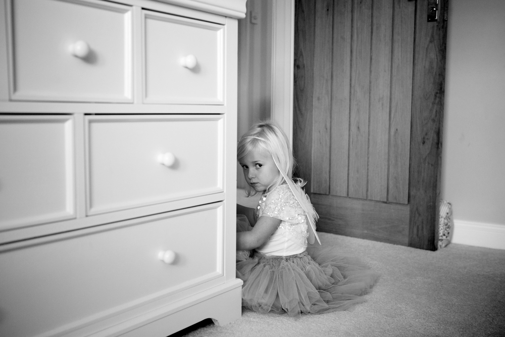 girl playing behind cupboard - Natural Photo Shoot Essex