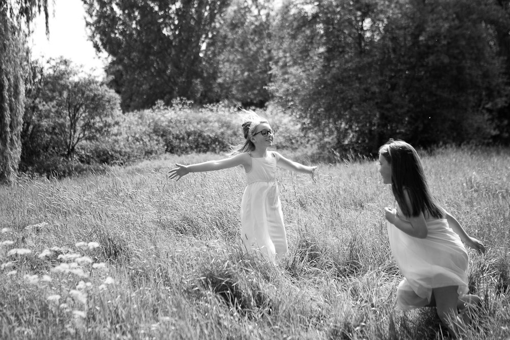 sisters playing in field