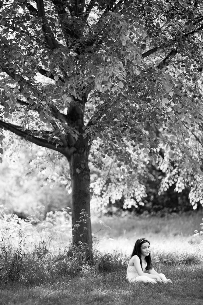 girl sitting under tree in park - chelmsford family photography