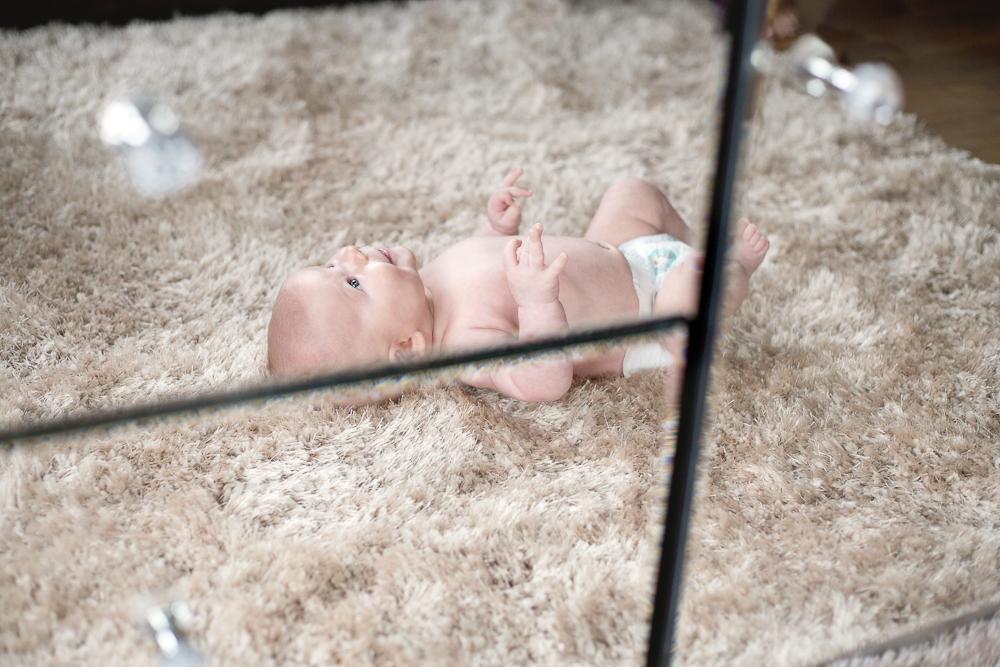 reflection of newborn baby in mirror