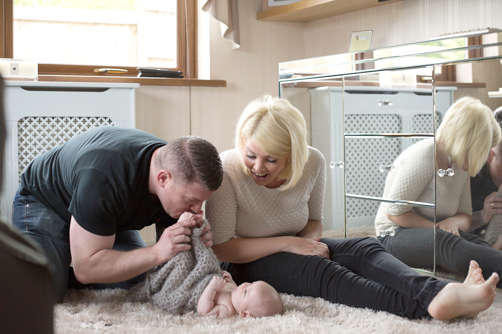 mum and dad playing with baby girl