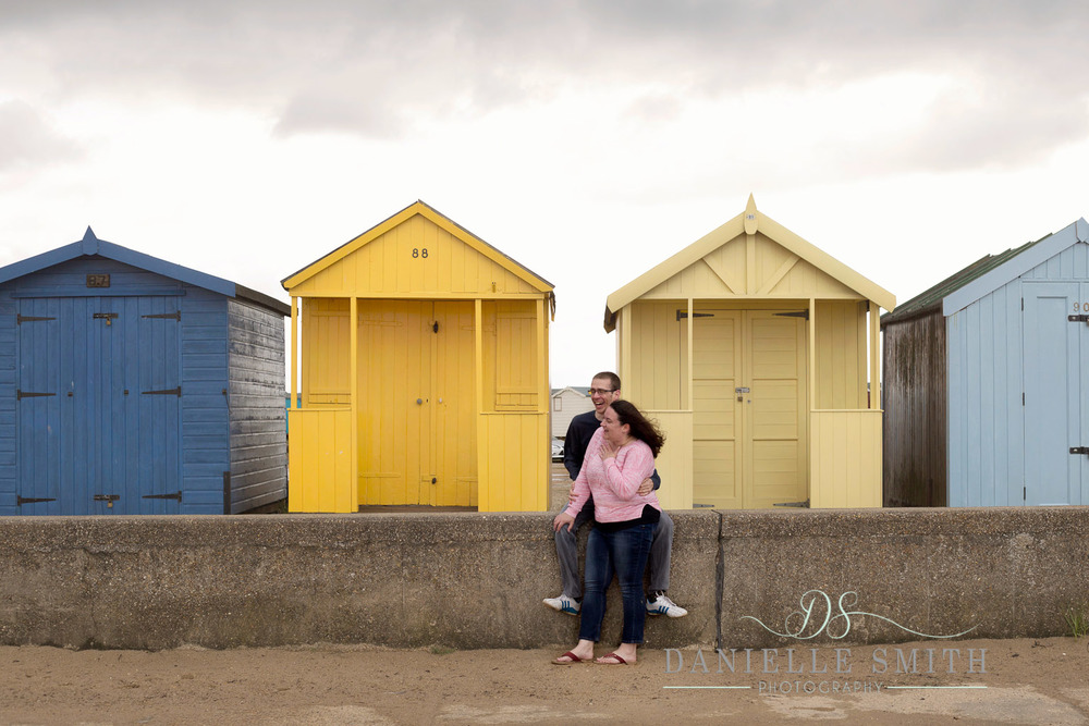 couple laughing - seaside engagement photo shoot