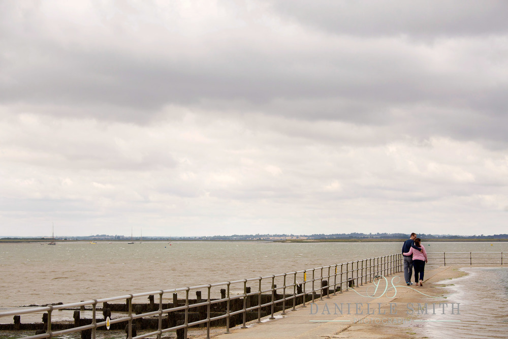 couple walking along by the seaside