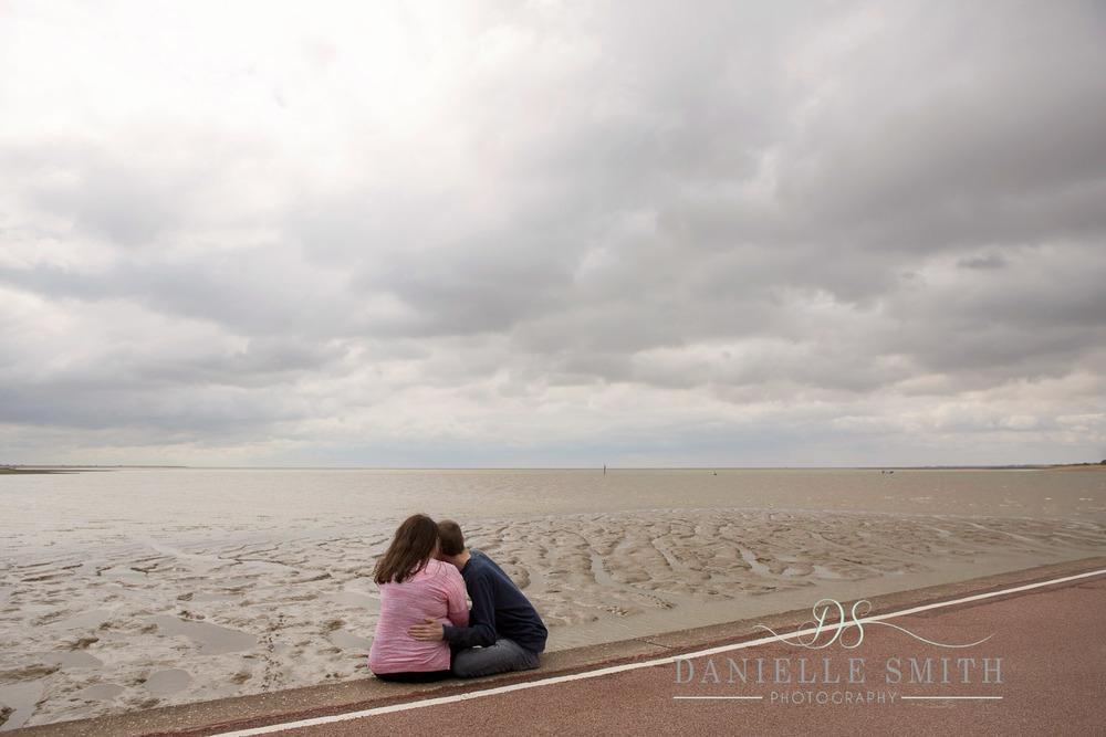 couple hugging - seaside engagement photo shoot