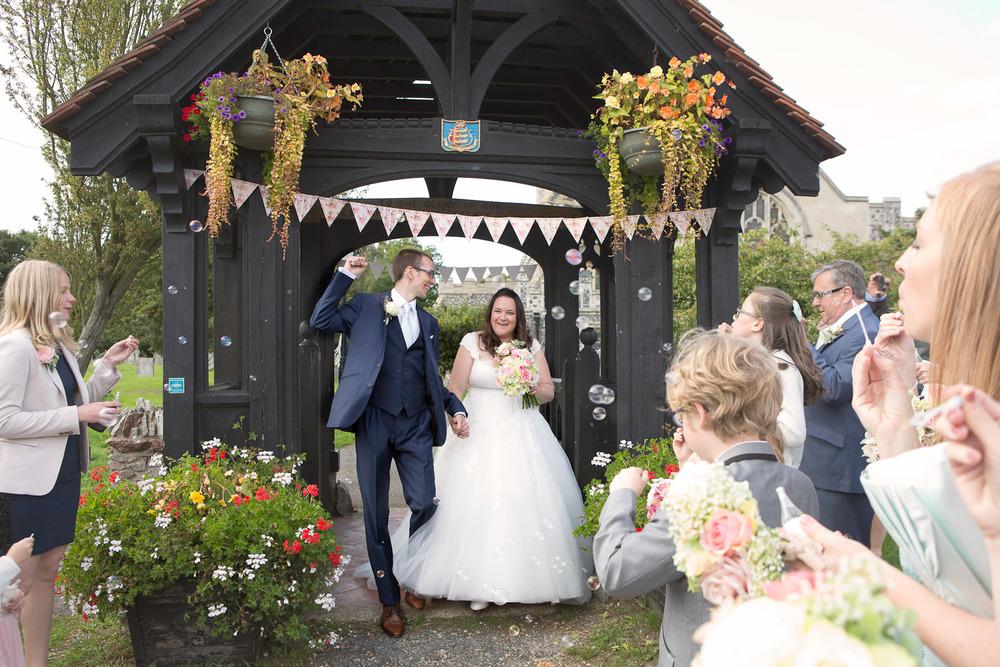 bride and groom with confetti bubbles
