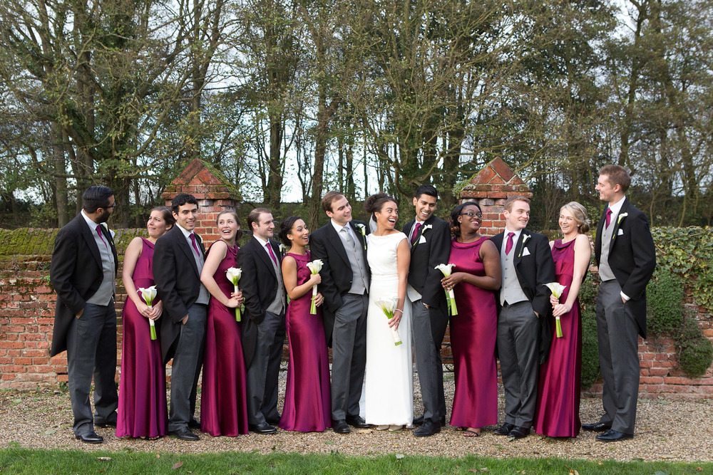 bridal party with maroon dresses