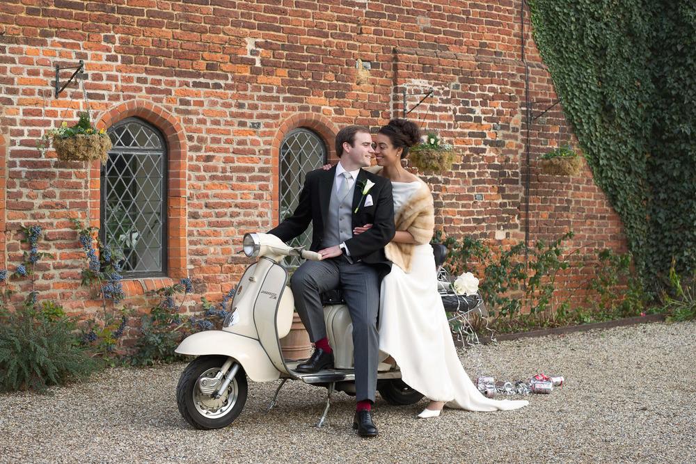 bride and groom sitting on vespa at Leez