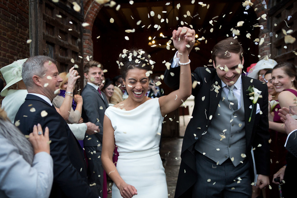 bride and groom with confetti - leez wedding photographer
