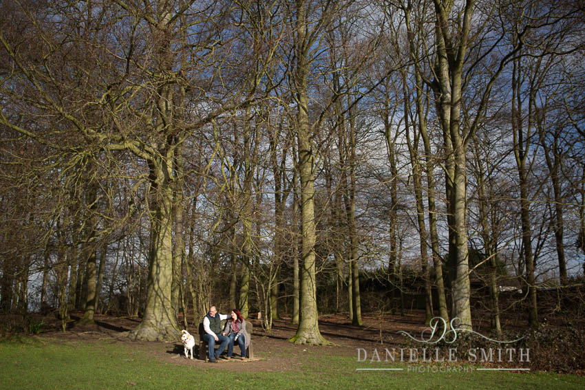 couple and their dog in woodland engagement photography session