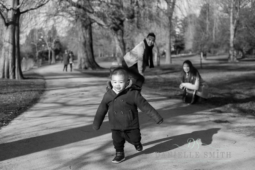 little boy running in park
