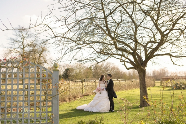 bride and groom in gardens at fennes wedding