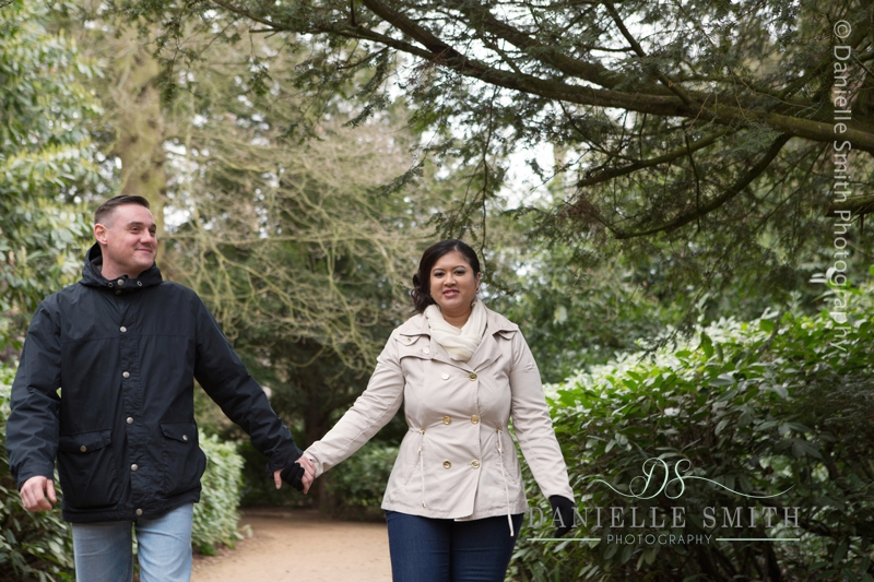 couple walking in hylands park chelmsford