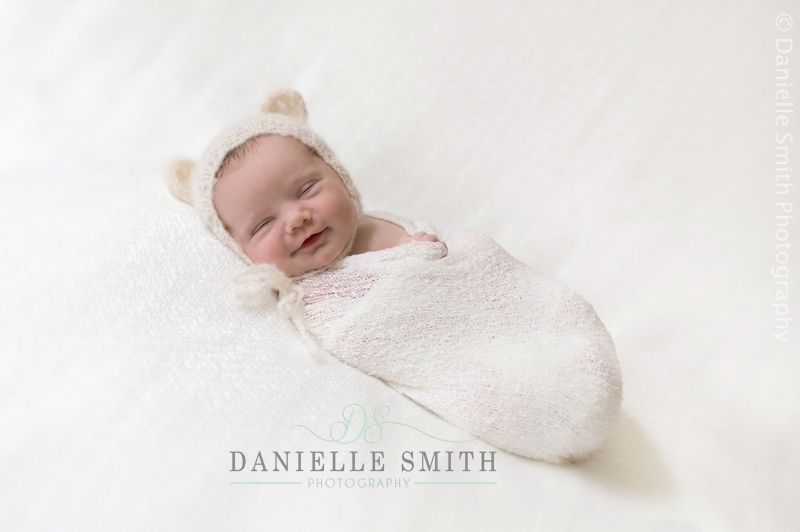 baby with teddy bear hat on