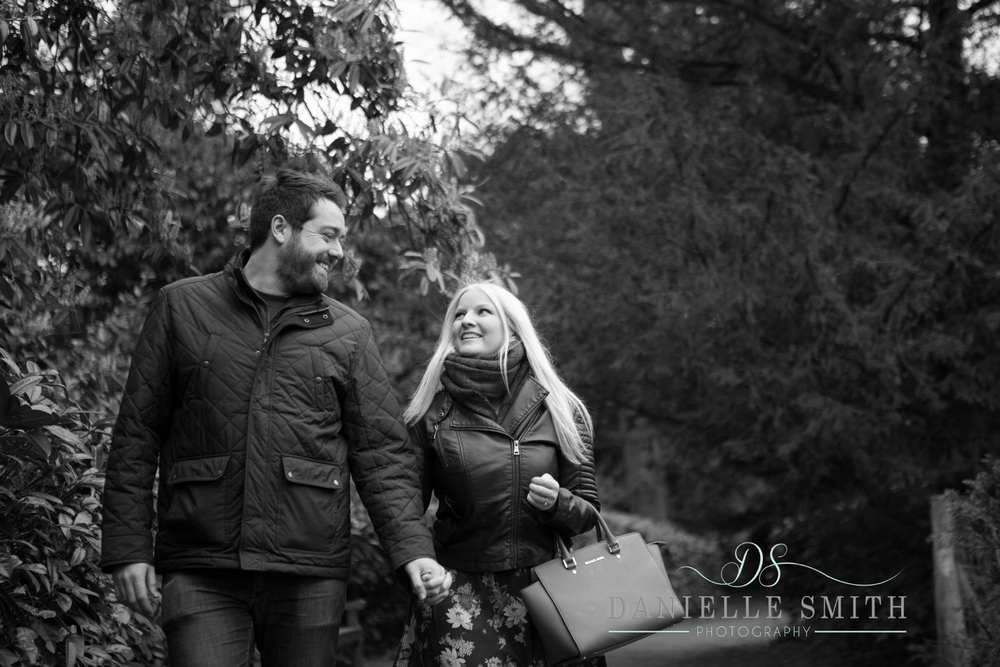 couple walking in park - pre-wedding photographer