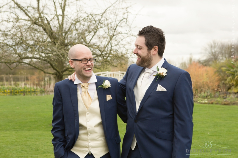 groom and best man laughing - spring wedding