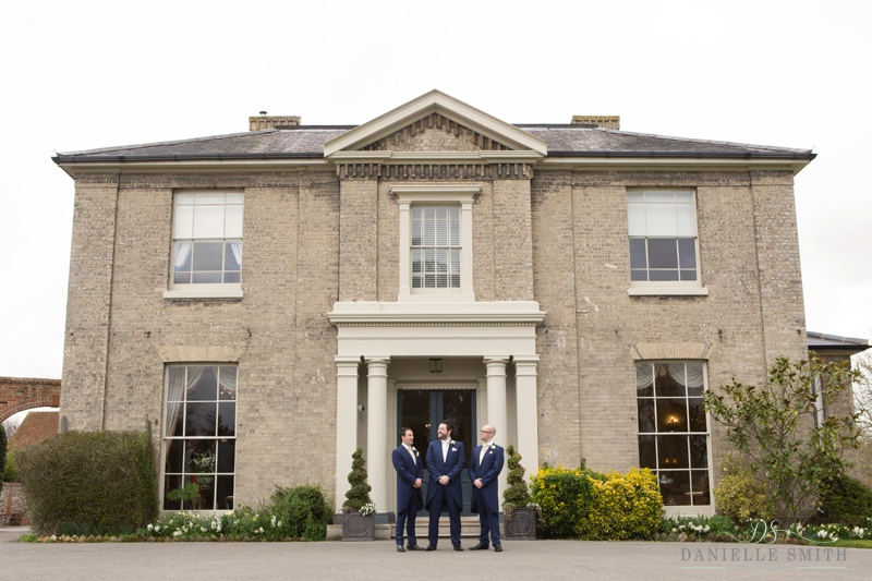 groom and groomsmen outside Fennes