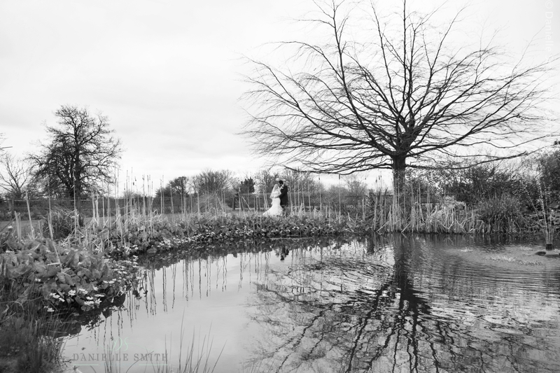 Bride and groom round lake - spring wedding at Fennes