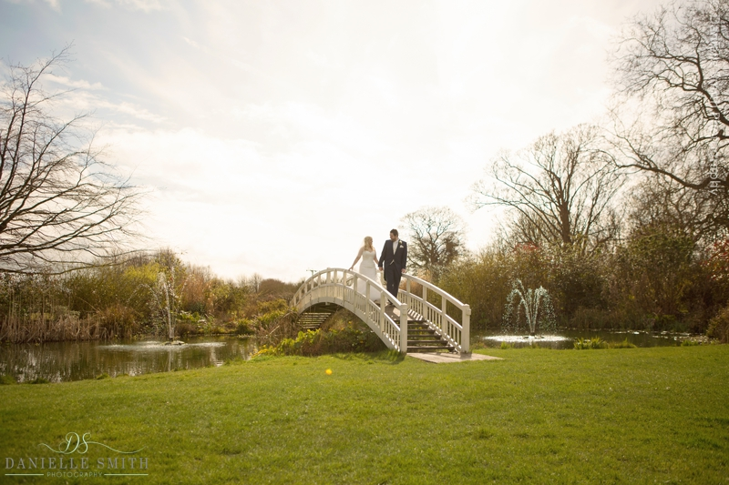 bride and groom on bridge at Fennes