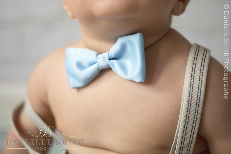 blue bowtie on boy - cake smash photography barking