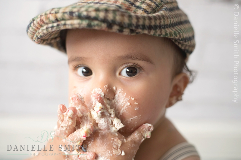 boy putting cake in his mouth - cake smash photography barking