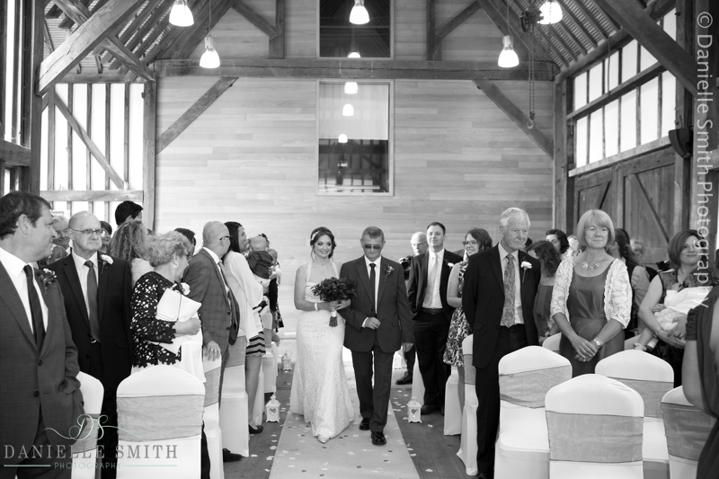 dad walking daughter down the aisle at barn wedding